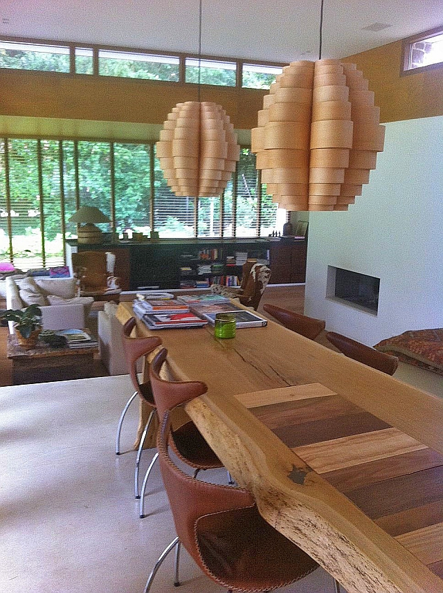 glow pendant light in ash wood above wooden table in living room