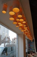 bespoke ceiling lights in maple wood for a wine bar in bruge - Blend