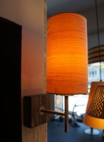 sconce lamp in maple wood against wall 1
