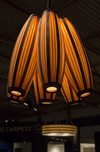 Pendal lighting in wood veneer in bistro above bar and tables in BIS expo_-_2