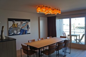 carillon ceiling lamp in maple wood - 22 different tubes above dining table