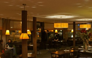 O-ring and small pendant lights in ash wood in restaurant